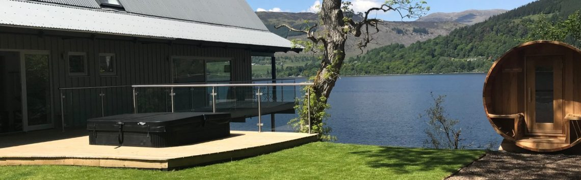 Boathouse lodge at loch tay with hot tub on decking