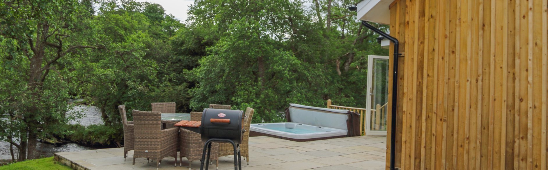 Hot Tub, BBQ and table and chairs on decking