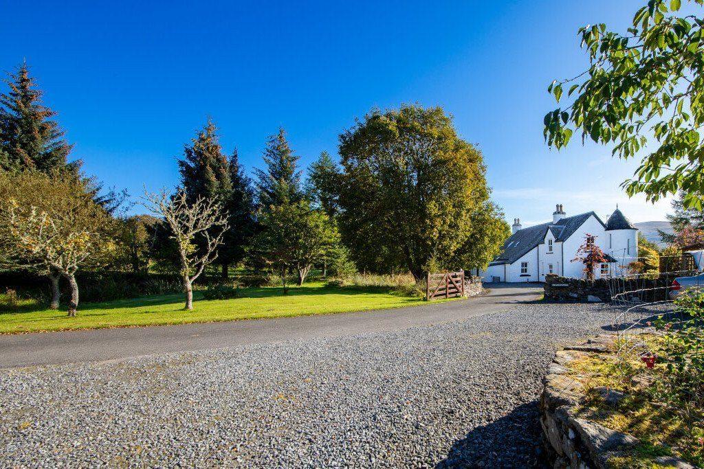 Craggantoul house entrance and gardens under a crisp blue sky